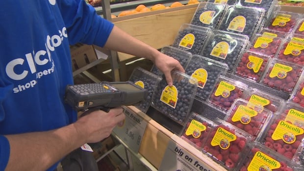 Regina Superstore employee shops for online customer at Prince of Wales Drive location.