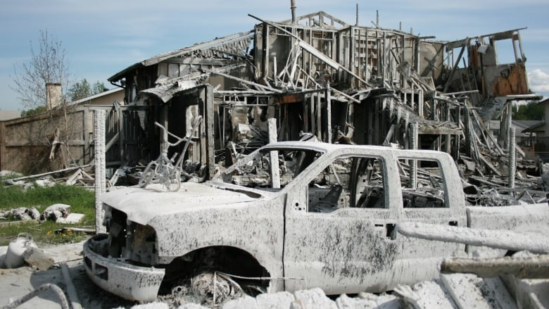 'No children were hurt, just their toys': Fort McMurray man finds hope among the ruins