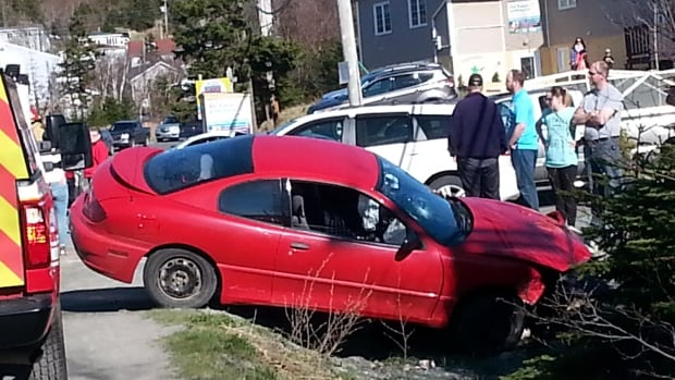 A vehicle that had been travelling toward the ferry in Portugal Cove struck this red car, as it was attempting to turn into a convenience store parking lot on May 19.
