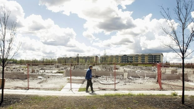 Farid El-Hayouni walks in front of the site where his house once stood. Researchers are studying the impact of the traumatic experience on residents.