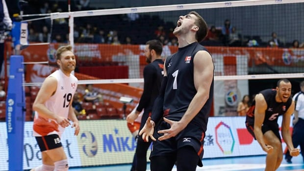 Canada's Tyler Sanders, centre, celebrates after his team defeated China in five sets en route to qualifying for the Rio Olympics.