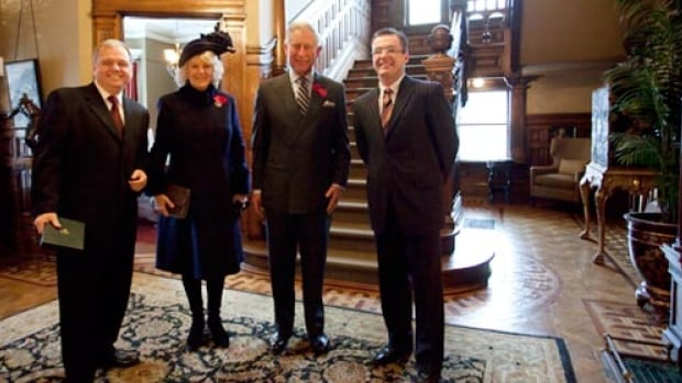 Kevin Nolan (left) and Robert Hall (right) are pictured at Ryan Mansion in St. John's with Prince Charles and his wife Camilla during a royal visit in 2009.