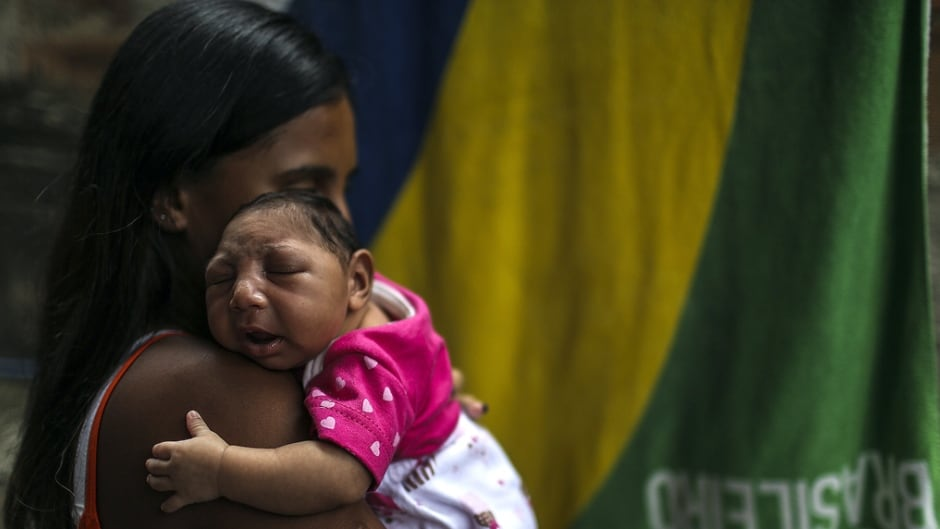 Leticia de Araujo holding her daughter, one-month-old Manuelly Araujo da Cruz, in February 2016.  Manuelly who was born with microcephaly and was exposed to the Zika virus during her mother's pregnancy.