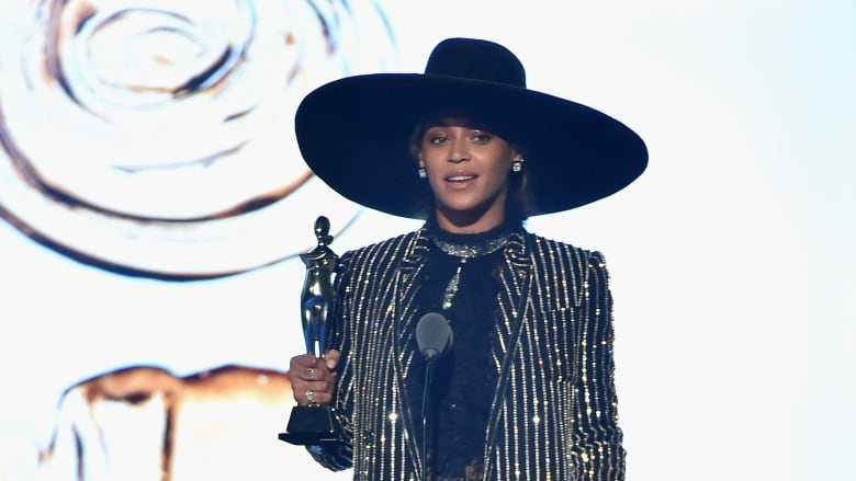 02653b3d924 Beyoncé Knowles accepts CDFA Fashion Icon Award onstage at the 2016 CFDA  Fashion Awards in New York Monday evening. (Theo Wargo Getty Images)