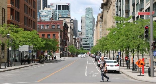 A man walks on de la Commune Street