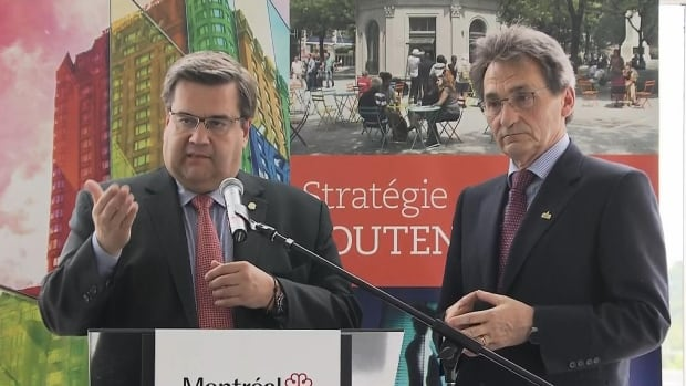 Montreal Mayor Coderre, accompanied by Richard Bergeron, who is in charge of the downtown strategy on Montreal's executive committee, outline plans for revitalizing the city's urban core on Wednesday.