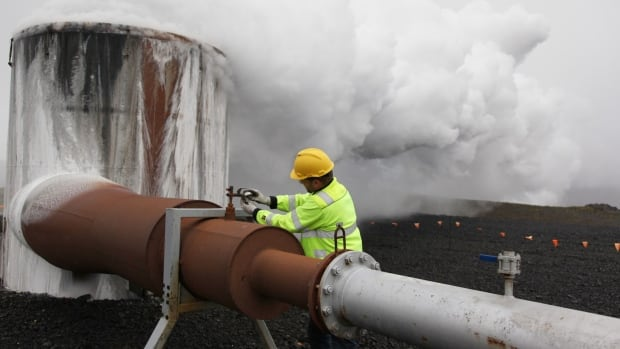 A CarbFix experiment's technical manager checks a valve at a test well at Reykjavik Energy's Hellisheidi geothermal power plant in Iceland.