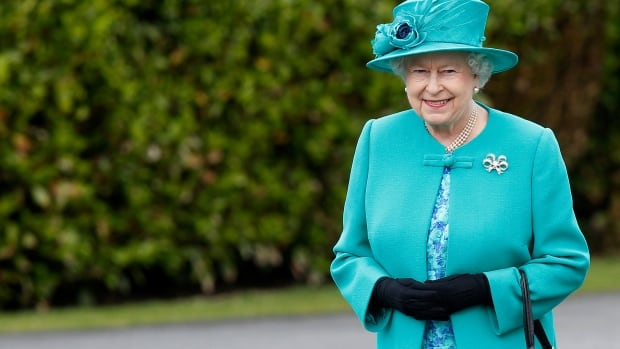Queen Elizabeth smiles after inspecting a Guard of Honour at the residence of the Irish president on May 17, 2011.