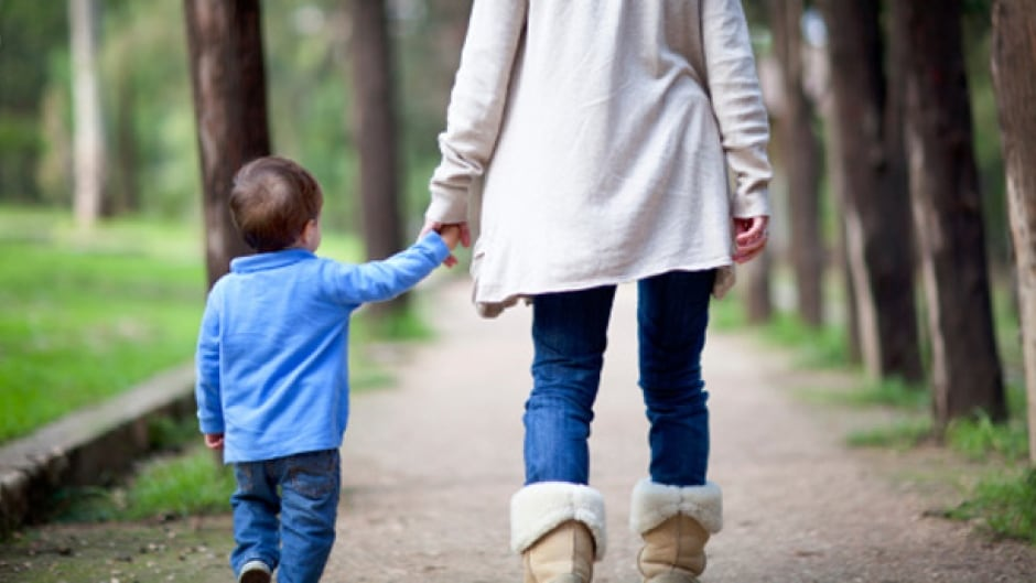 Woman with her kid walking in a park