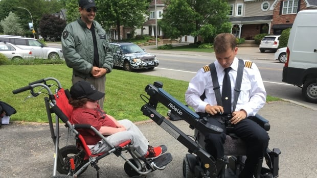 Air Canada pilot Frédérick Bélanger shows 15-year-old Antoine Dupont the features of his new chair, which includes a real pilot seat complete with sheepskin and a five-point seat belt.