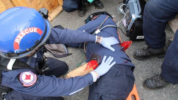 Emergency crews practice their response to serious injuries during a training exercise.