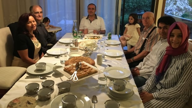 Olcay Seki (second on the right) says his family welcomes as many as 15 guests to their dinner table for Iftar during the month of Ramadan.