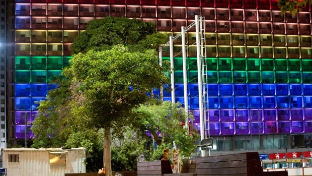Tel Aviv city hall lit up with rainbow flag colours in solidarity with Florida's shooting attack victims on Sunday.  The rampage in Orlando, Florida, left more than 50 people dead as people around the world celebrated LGBT Pride Month.