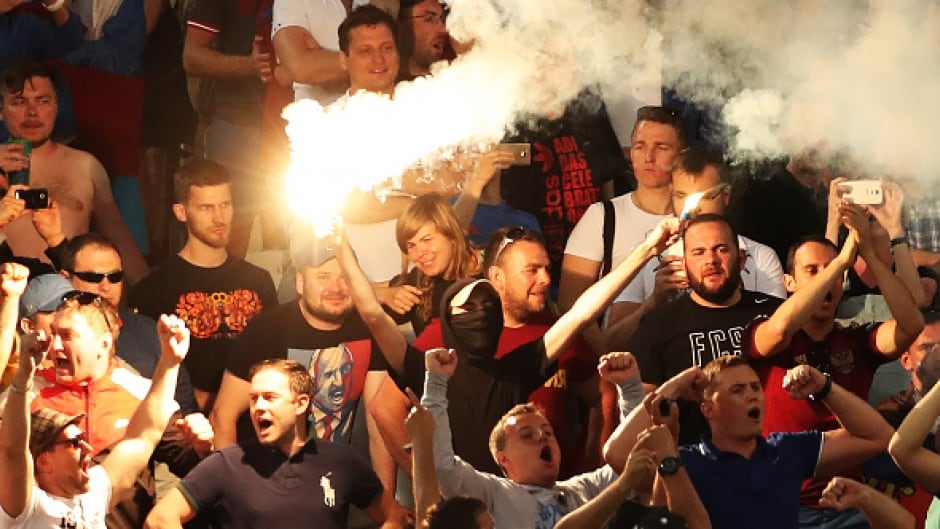 A Russian fan holds up two flares during the Group B match between England and Russia held in Marseille, France at the Euro 2016. UEFA imposed a fine on the Russian soccer federation and threatened to suspend the country from the tournament if violence continued.