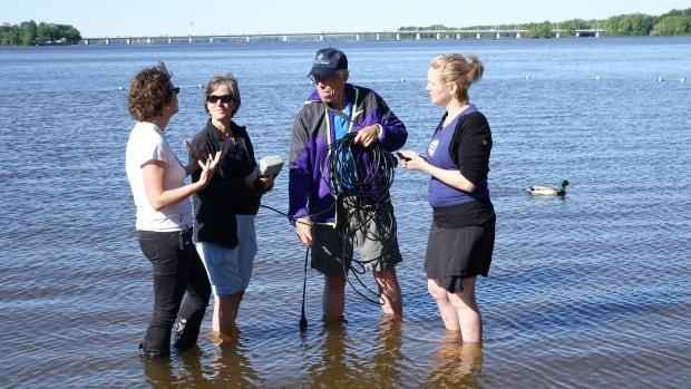 The Ottawa Riverkeeper's Meaghan Murphy (left) trains volunteer 'Riverwatchers' Wendy Ryan and Howard Powles with help from Water Rangers app developer Kat Kavanagh (right).