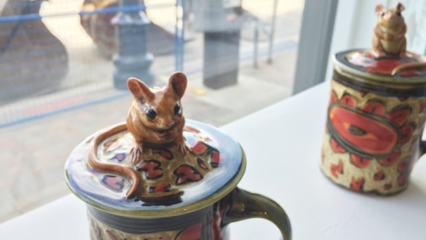 Ceramic containers topped with field mice.