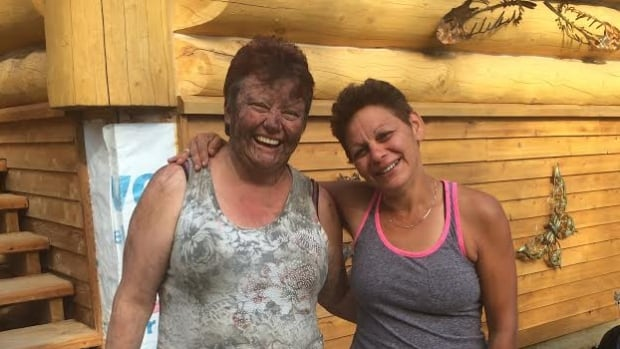 Joanne Barnaby, left, when she was reunited with her friend Tammy Cauldron. Barnaby was stalked in the bush for 12 hours by a wolf.