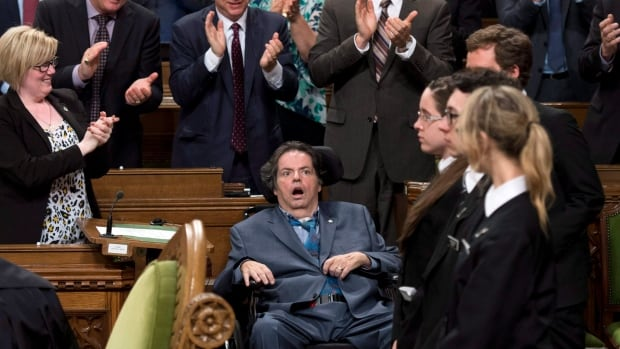 Mauril Belanger receives a standing ovation during a vote on his private member's bill to make the national anthem more gender neutral in the House of Commons on Parliament Hill on Wednesday, June 15, in Ottawa.