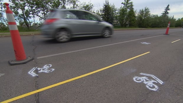 These 'improved' bike lanes appeared overnight Wednesday on Saskatchewan Drive.