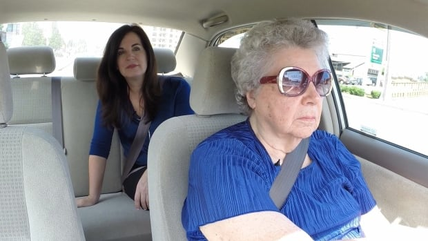 Barb Fleming, seen here with CBC reporter Erica Johnson, feels like she's driving Miss Daisy, because an airbag recall has forced passengers into the back seat.