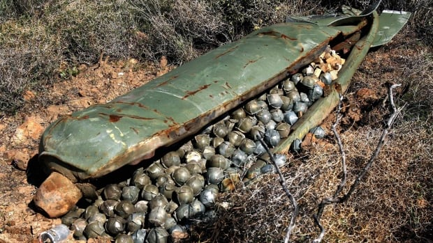In this Nov. 9, 2006 file picture, a Cluster Bomb Unit containing more than 600 cluster bombs sits in a field in the southern village of Ouazaiyeh, Lebanon.