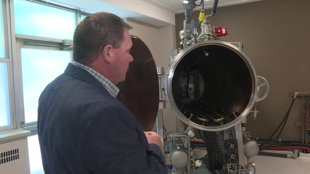 Dale Hilton, a proponent of so-called green funerals, shows the pressurized vessel his Smiths Falls, Ont., business uses to break down human remains. The liquid waste is then disposed into the town's sewer system, while powdered remains are returned to the loved one's family.