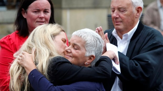 Jean Leadbeater, centre,  the mother of Labour MP Jo Cox, embraces her daughter Kim Leadbeater, with her husband Gordon, in Birstall, West Yorkshire, England,  Saturday following the reading of a statement about Cox.