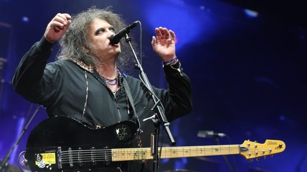 Robert Smith of The Cure performs on Day 3 of Lollapalooza 2013 at Grant Park on Aug. 4, 2013, in Chicago.