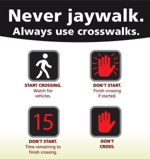Never jaywalk sign