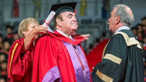 British-Canadian businessman Victor Dahdaleh receives an honorary doctorate Monday at York University in Toronto as the school's chancellor, former Ontario finance minister Greg Sorbara, looks on. The Panama Papers revealed Dahdaleh is the mystery middleman in a global corruption scandal involving aluminum company Alcoa and the Bahraini government.