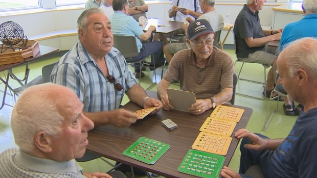 Seniors play bingo at a Mississauga, Ont. community centre. The city received a single complaint about the activity, alleging that is illegal under Ontario gaming laws, and a letter from the city sent to the Mississauga Seniors' Council has made some seniors nervous about playing. Some seniors are defiant, saying if they have to go to jail, they will.