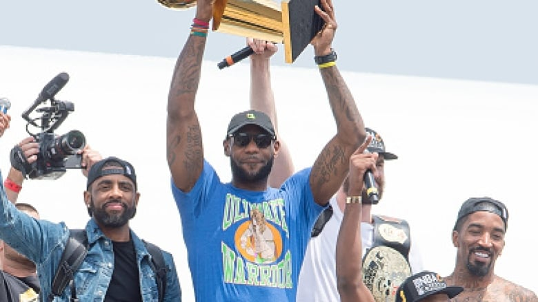 LeBron James (centre) returns to Cleveland wearing a blue and yellow