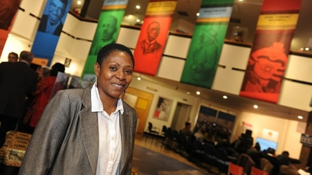 Afua Cooper stands by images of some of the great Canadians she'll be teaching students about.