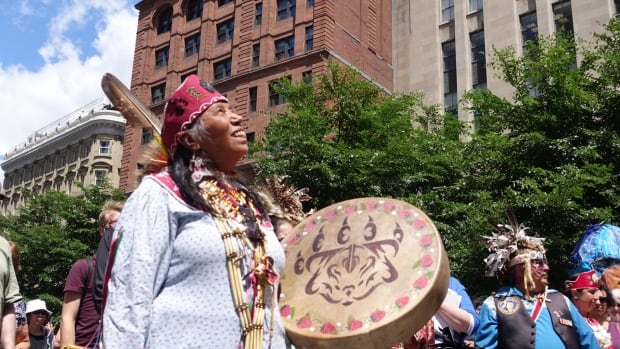 Sedalia Kawennotas celebrates National Aboriginal Day in Old Montreal on Tuesday.