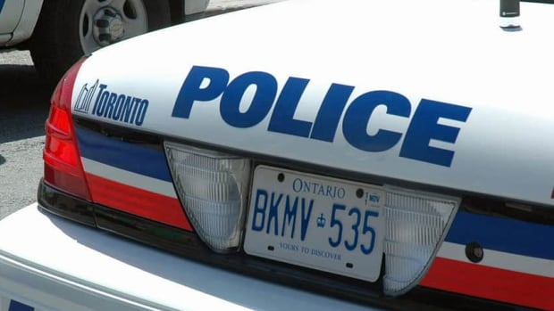 Toronto police say a man is facing seven charges after two officers were slightly injured on Tuesday while they were attending to an assault call in East York.