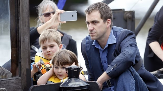 Brendan Cox and his children, Cuillin and Lejla, make their way to a memorial service for slain MP Jo Cox, a vocal proponent of Britain remaining in the EU.