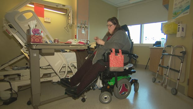 Kelly Anne Denton passes the time in the hospital by knitting.  She cannot return home until the family makes their house wheelchair accessible.