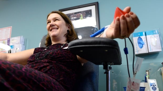 Health Minister Jane Philpott donates blood at Canadian Blood Services in December 2015.