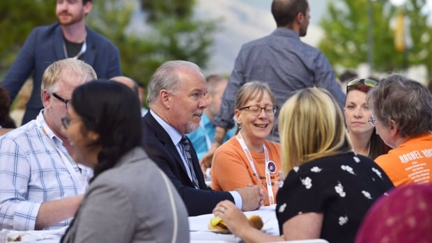 BC NDP leader John Horgan, middle, said on June 26, 2016, at a party meeting in Kamloops, that if elected in 2017 his party will raise the minimum wage in B.C. to $15 per hour in its first term. The current rate is $10.45.