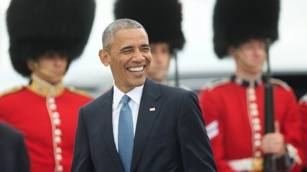 President Barack Obama smiles as he walks across the tarmac upon his arrival on Air Force One in Ottawa on Wednesday.