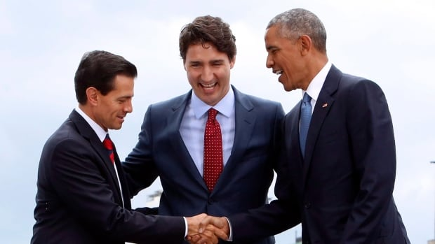 Prime Minister Justin Trudeau (centre), Mexican President Enrique Pena Nieto (left) and U.S. President Barack Obama (right) laughed after fumbling a three-way handshake Wednesday at the North American Leaders Summit in Ottawa.