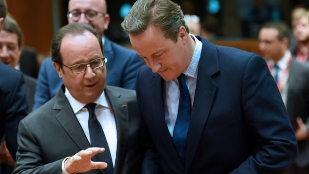 French President Francoise Hollande speaks with Britain's Prime minister David Cameron during an EU summit meeting on June 28.