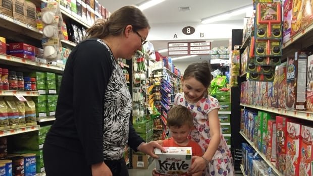 Erica Wiggins shops for groceries with her children in Georgia, Vt. A new GMO-labelling law goes into effect July 1 in the state.