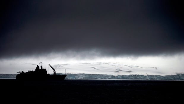 Chile's Navy ship Aquiles moves alongside the Hurd Peninsula, seen from Livingston Islands, part of the South Shetland Islands archipelago in Antarctica. Antarctica's ozone hole is finally starting to heal, a new study finds.