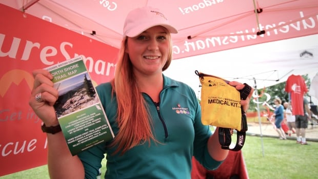 Adventure Smart's Emma Courtney holds up a few of the items that anyone heading into the wilderness should be packing.
