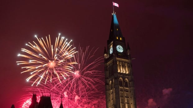 Fireworks light up the sky red behind the Peace Tower during Canada Day celebrations on Parliament Hill on Friday, July 1, 2016 in Ottawa.
