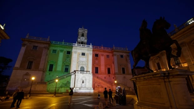 Rome's Campidoglio Capitol Hill is lit with the colours of the Italian flag Saturday. Nine Italians were killed in an extremist attack in Dhaka, Bangladesh.