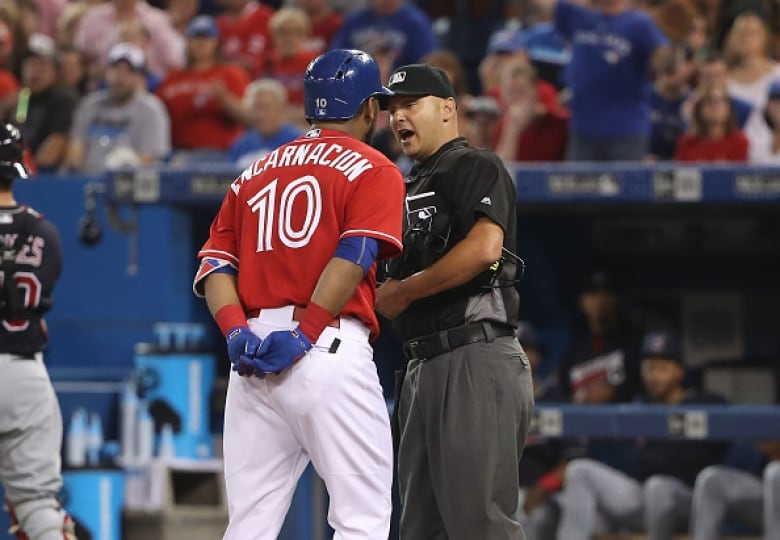 3cc9da6ef00 Toronto s Edwin Encarnacion argues with home plate umpire Vic Carapazza on  Friday after a called third strike