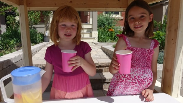 Eliza and Adela Andrews set up a lemonade stand in July 2016 to raise money for summer camp.