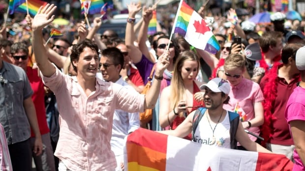 Bassel Mcleash, right, is thrilled to march in his first ever Pride parade next to Justin Trudeau, the first sitting Canadian prime minister to ever march in a Pride parade.